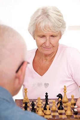 Older Couple Playing Chess Art Print