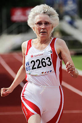 Athlete Photograph - Older Female Athlete Runs To Camera by Alex Rotas