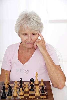 Chessboard Photograph - Older Lady Playing Chess by Lea Paterson