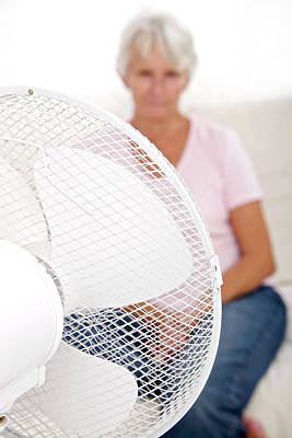 Familiar Object Photograph - Older Lady With An Electric Fan by Lea Paterson