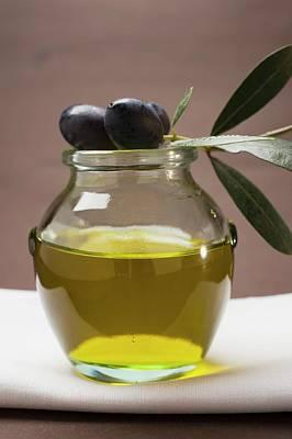 Black Olive Photograph - Olive Sprig With Black Olives On Jar Of Olive Oil by Foodcollection