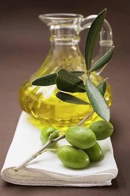 Olive Sprig With Green Olives, Carafe Of Olive Oil Behind Art Print