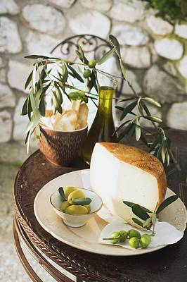 Olives, Cheese, Crackers And Olive Oil On Table Out Of Doors Art Print