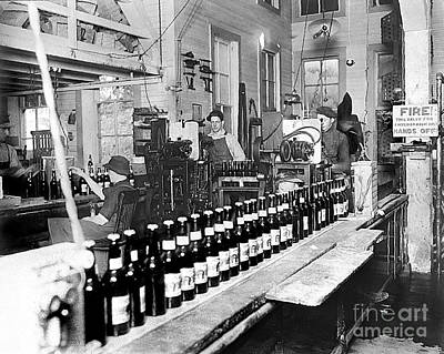 Photograph - Olympia Brewing Company Bottling Line 1914 by Joe Jeffers