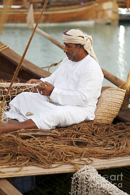 Dhow Photograph - Omani Net-making Demonstration by Paul Cowan