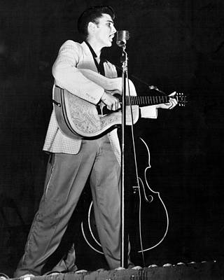 Elvis Presley Photograph - On Stage Elvis Presley Plays And Sings by Retro Images Archive