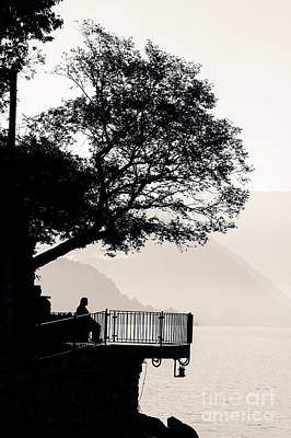 One Old Man Sitting In Shade Of Tree Overlooking Lake Como Art Print
