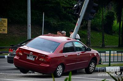 Photograph - Oops Car Accident On Traffic Light At Road Intersection by Imran Ahmed