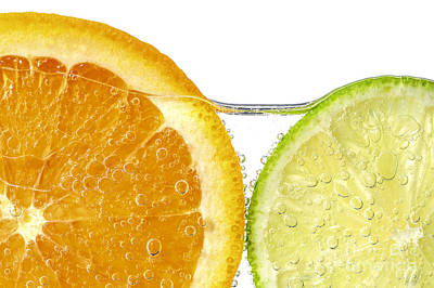 Blue Hues - Orange and lime slices in water by Elena Elisseeva