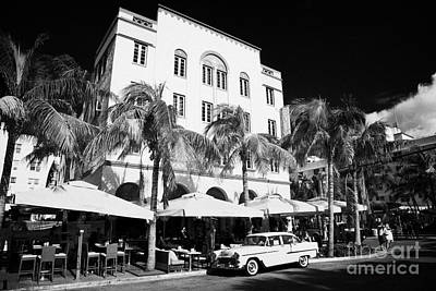 Orange Chevrolet Bel Air In The Cuban Style Outside The Edison Hotel Art Print by Joe Fox