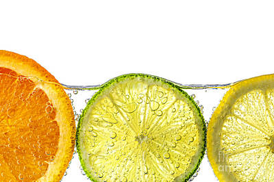 Orange Lemon And Lime Slices In Water Art Print by Elena Elisseeva