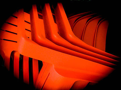 Photograph - Orange Plastic Chairs by Christy Usilton
