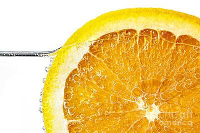 Orange Slice In Water Art Print by Elena Elisseeva