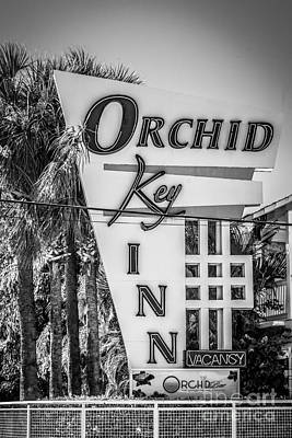 White Orchid Photograph - Orchid Inn Sign Key West - Black And White by Ian Monk