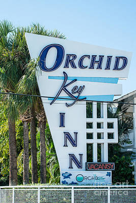 Multi Colored Photograph - Orchid Inn Sign Key West by Ian Monk