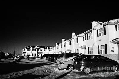 outdoor parking lot with vehicles outside row of condominium starter homes during winter Saskatoon S Art Print