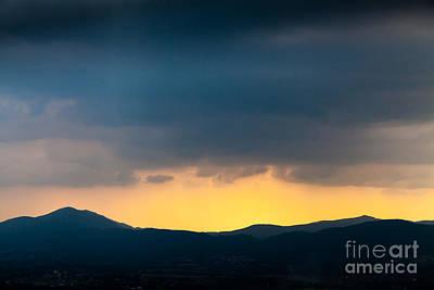 Overcast Dark Sky Rain Clouds With Yellow Glow Beyond Hills On H Art Print
