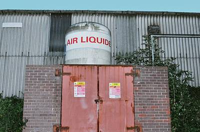Oxygen Wall Art - Photograph - Oxygen Tank At Rear Of Factory by Robert Brook/science Photo Library