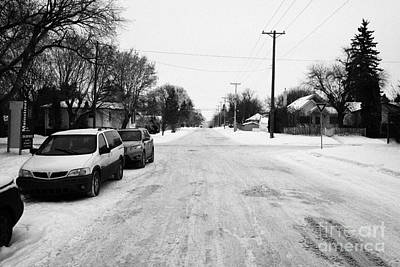 packed snow in the middle of a residential street pleasant hill Saskatoon Saskatchewan Canada Print by Joe Fox