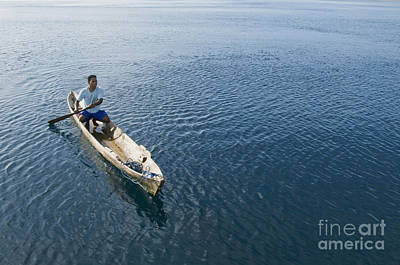 Photograph - Paddling A Canoe Off Atauro Island by Dan Suzio