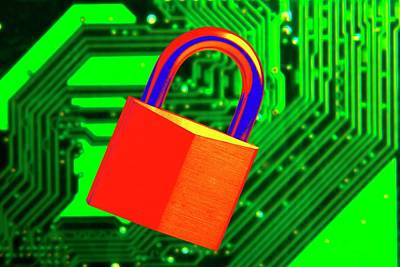 Circuit Photograph - Padlock And A Circuit Board by Victor De Schwanberg
