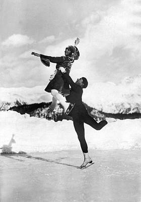 Figure Skater Photograph - Pairs Skaters Doing A Lift by Underwood Archives
