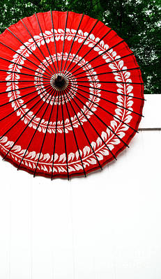 Paper Umbrella With Swirl Pattern On Fence Art Print by Amy Cicconi