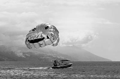 Parasailing With Smiley Face - In Black And White Art Print by Colin Utz