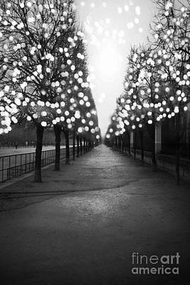 Photograph - Paris Surreal Black And White Photography - Paris Tuileries Garden Fairy Lights Row Of Trees by Kathy Fornal