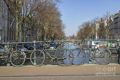 Parked Bikes On A Bridge In Amsterdam Art Print