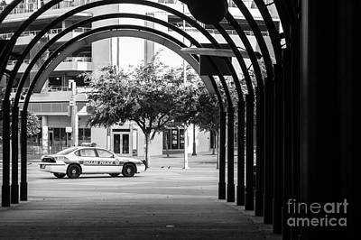Photograph - Parked Dallas Police Car With Arched Walkway by Imagery by Charly