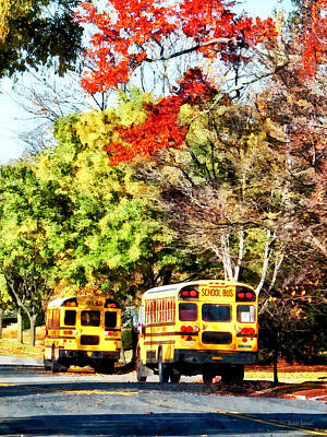Bus Photograph - Parked School Buses by Susan Savad