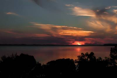 Photograph - Partial Eclipse Sunset by Debra Forand