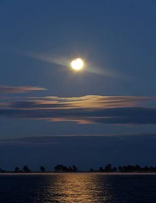 Partial Lunar Eclipse Over Coastal Lagoon Art Print by Luis Argerich