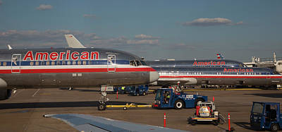 American Airlines Photograph - Passenger Airliners At An Airport by Jim West