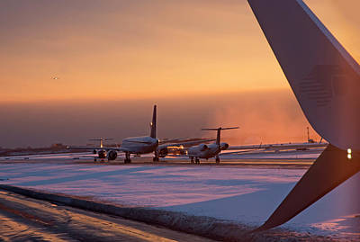 Passenger Airliners Taxiing At Dawn Print by Jim West