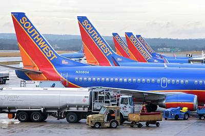 Passenger Jet Airliners At Airport Art Print by Jim West
