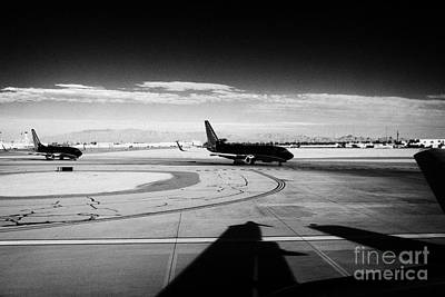 Airlines Photograph - passenger jets waiting in line to take off at McCarran International airport Las Vegas Nevada USA by Joe Fox