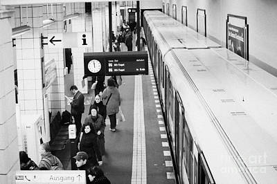 U-bahn Photograph - passengers along ubahn train platform Friedrichstrasse Friedrichstrasse u-bahn station Berlin by Joe Fox