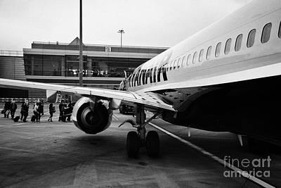 Passenger Plane Photograph - Passengers Boarding Ryanair Flight At Dublin Airport Terminal 1 Ireland by Joe Fox