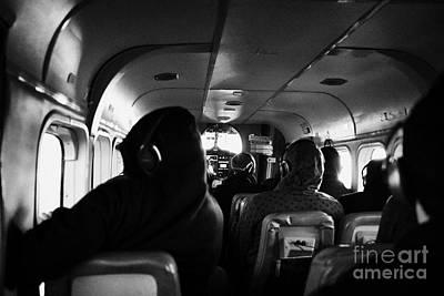 Passenger Plane Photograph - Passengers On Board Dehaviland Twin Otter Light Aircraft Sightseeing Flight To Grand Canyon by Joe Fox