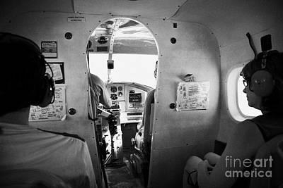 Passenger Plane Photograph - Passengers On Board Flight In A Dehaviland Dhc-3 Otter Seaplane At The Dry Tortugas Florida Keys Usa by Joe Fox