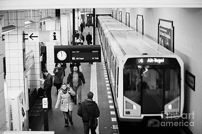 passengers on ubahn train platform as train leaves Friedrichstrasse u-bahn station Berlin Germany Art Print