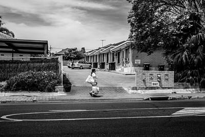 Home Photograph - Passing By Suburban Apartments by Paul Donohoe