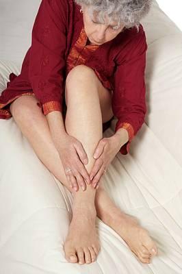 Rubbing Photograph - Patient Nursing A Sore Ankle by Lea Paterson