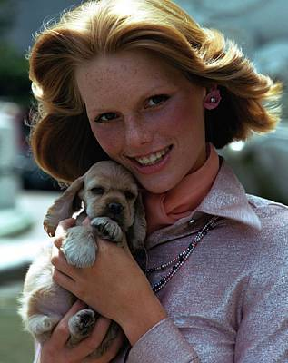 Dog Jewelry Photograph - Patti Hansen Carrying A Puppy by William Connors