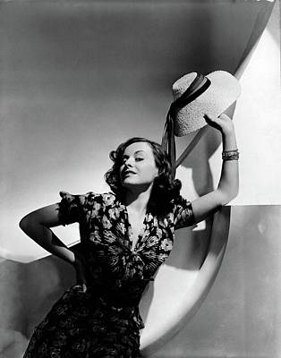1930s Fashion Photograph - Paulette Goddard Holding A Straw Hat by Horst P. Horst