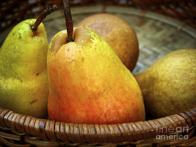 Still Life Royalty-Free and Rights-Managed Images - Pears in a basket by Elena Elisseeva