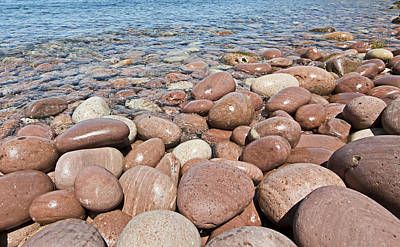 Portrait Photograph - Giantic Pebbles Close To Cala Pilar In Menorca Island - Pebbles Beach by Pedro Cardona