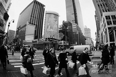 Pedestrians Crossing Crosswalk On 7th Ave And 34th Street Outside Macys New York City Usa Art Print by Joe Fox